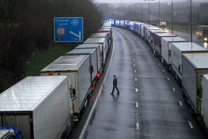 Trucks in England parked along a motorway that led to the port of Dover.  The port closed after France announced it would ban cargo from the UK trying to stop the spread of a variant of the coronavirus.