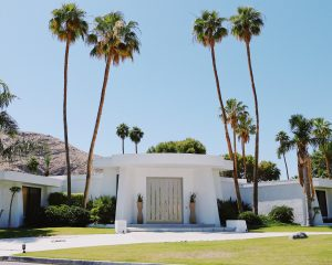 white concrete house near palm trees during daytime