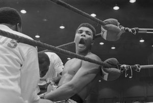 (Original signature) Close up of Cassius Clay after defeating Sonny Liston for the World Heavyweight Championship.
